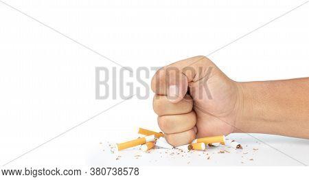 Man Hand Smash Cigarette On White Background, Man's Fist Crushing Cigarettes, Stop Smoking Initiativ