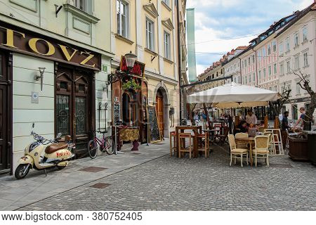Ljubljana, Slovenia - July 16th 2018: Rotovz Or City Hall In Mestni Trg, With A Vespa Parked Outside