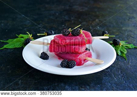 Dessert, Portioned Homemade Ice Cream Or Popsicles Made From Red Currants And Blackberries On A Whit