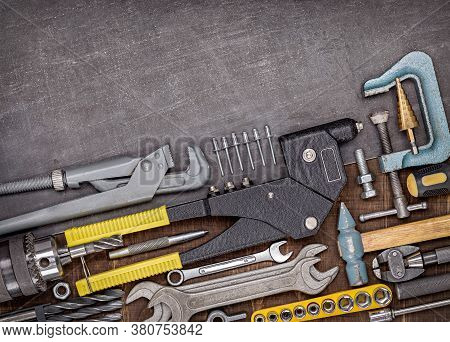 A Set Of Plumbing Tools For Homework. Background Of Household Tools. Close-up, Studio Shot.