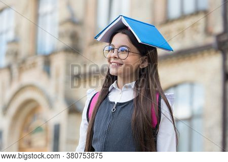 Study With Us. Happy Child Hold Book On Head. Back To School. Home Study. Home Schooling. Formal, In