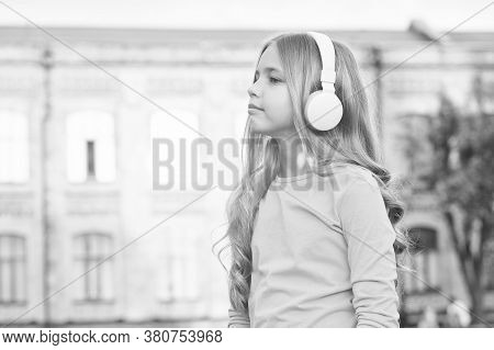 Are You Listening Closely. Little Child Listen To Music Outdoors. Small Listener Wear Headphones. Li