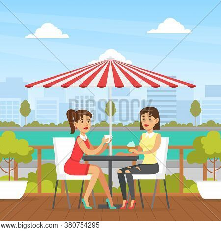 Two Young Women Sitting In Cafe Outdoors, Two Female Friends Drinking Coffee And Chatting, Best Frie