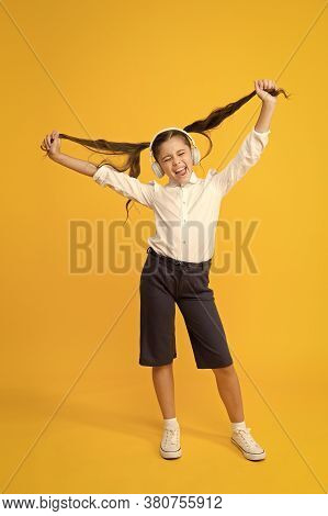 Grow Hair With Music. Small Child Wearing Long Tail Hairstyle And Headphones For School. Little Girl