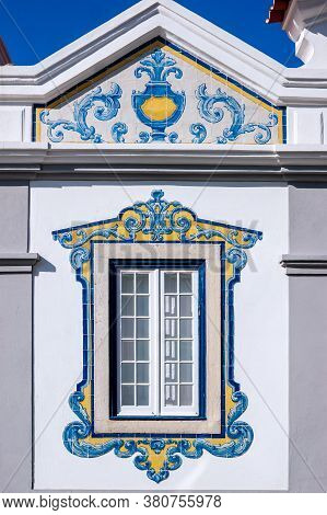 Window Decorated With Typical Portuguese Tiles With Geometric Shapes And White, Blue And Yellow Colo