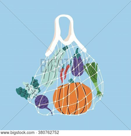 Mesh Bag With Vegetables On A Blue Background. Zero Waste. Eco Bag With Various Healthy Products. Va