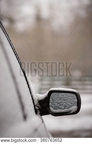 The Beginning Of Spring. Unexpected Snow Covered Cars And Roads. Door Mirror And Glass Of A Car In T