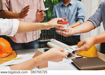 Real Estate Brokers And Customers Entering Home Sale Contracts. Buying And Selling Houses And Real E