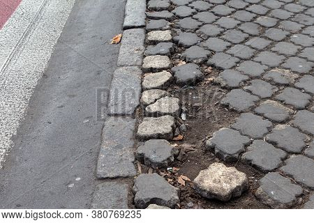 Damaged Road With Potholes, Caused By Freeze-thaw Cycles In Winter. Bad Road. Broken Pavements Pavin