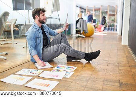 Graphic designer in a design agency choosing a color for the design of a website