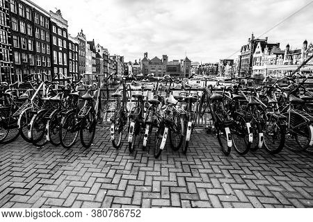 Amsterdam, The Netherlands - December 12, 2009: Bicycles On The Street Near Water Canal. Bicycle Is