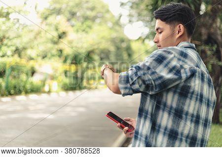 Asian Man Waiting For Uber Taxi