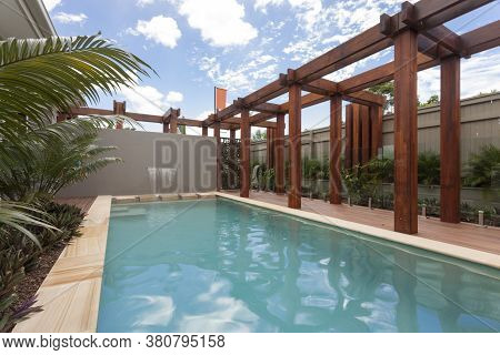 A Large Swimming Pool At Modern House Backyard