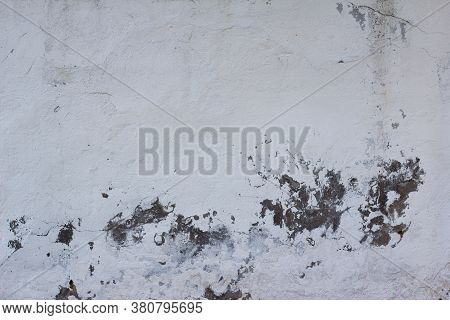 Wall Texture With Old White Plaster That Has Cracked And Fallen Off