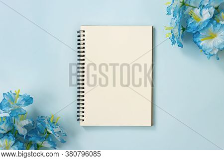 Spiral Notebook Or Spring Notebook In Unlined Type And Blue Flowers At Bottom Left And Top Right Cor