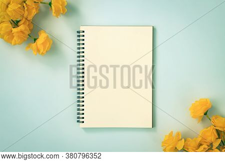 Spiral Notebook Or Spring Notebook In Unlined Type And Orange Flowers At Bottom Right And Top Left C