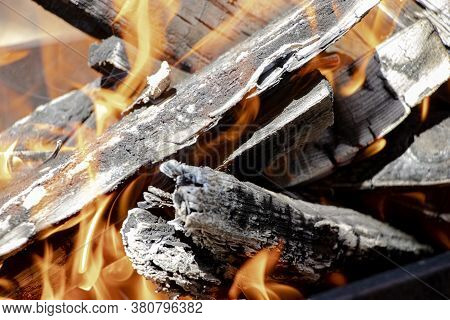 Burning Firewood And Coals In The Grill. Close-up. Macro Shooting. Burning Fire. Grilling Meat. Coal