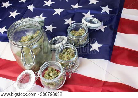 United States Usa Government And Cannabis Law, Marijuana Buds In Jars. Flag Background With Copy Spa