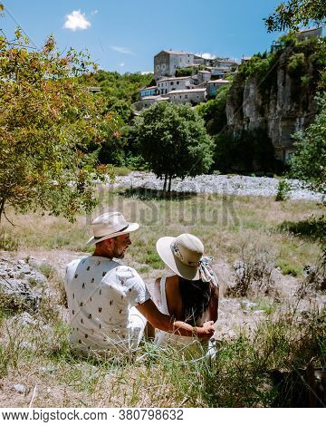 Couple Visit Ardeche France, View Of The Village Of Balazuc In Ardeche. France
