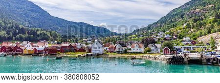 View At Solvorn, A Picturesque Little Village With White Wooden Houses Along Lustrafjorden On A Summ