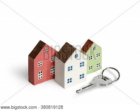 Wood Miniature Houses And House Key Isolated On White. Real Estate, Insurance Concept, Mortgage, Buy