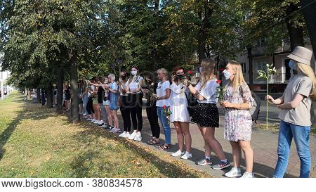 Brest, Belarus. August, 13, 2020. Belarusian Women With Flowers Lined Up In A Chain Of Peaceful Prot
