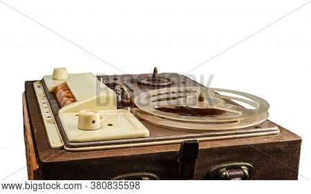A Vintage Reel Tape Recorder With A Raised Lid. Isolated On White Background.