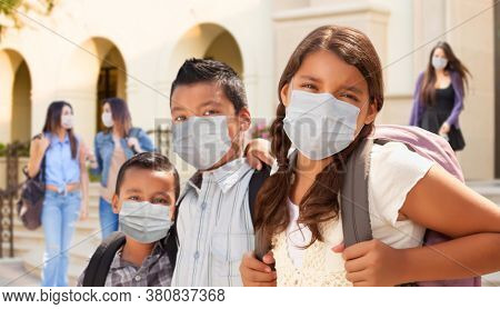 Young Students on School Campus Wearing Medical Face Masks.
