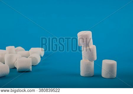 Marshmallows In The Shape Of A Heart On A Blue Background Close-up And Copy Space. Marshmallow Patte