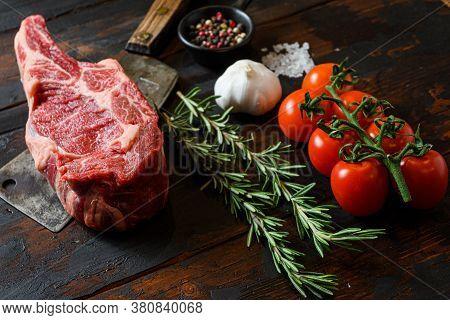 Raw Cowboy Steak On Meat Cleaver. Organic Farm Marbled Prime Black Angus Beef. Dark Wooden Backgroun
