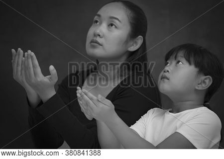 Asian Face Woman And Child Praying And Worship To God Using Hands To Pray In Religious Beliefs And W