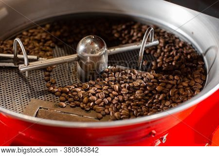 Aromatic Coffee Beans Situating In Modern Equipment With Grain Chiller. Industry Concept. A Modern M