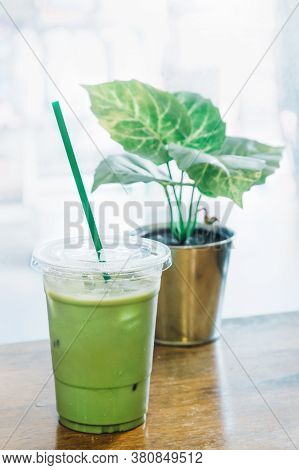 Matcha Green Tea And Fresh Milk Mixed With Ice In The Plastic Cup At The Coffee Shop In Thailand Rea