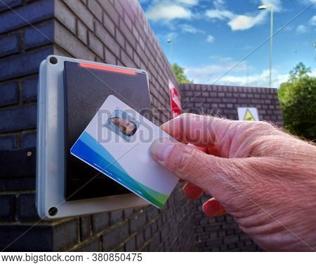 Red Light On An Electronic Card Reader, Showing A Man Being Refused Access To A Secure Location