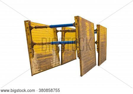 Two trench boxes isolated on a white background. Also called trench shields or trench sheets, on the site of sewer replacement works in north east Italy.