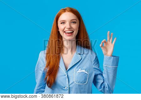 Alright, No Worries Anymore. Cheerful And Relieved Smiling Happy Redhead Girl In Nightwear, Ready Sl