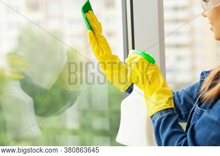 The Cleaning Lady Does The Cleaning In The Office With A Wet Cloth