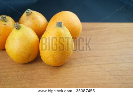 Five Whole Loquats With Black Background