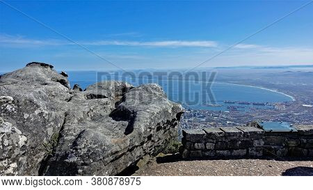 Magnificent Panorama From The Top Of Table Mountain. An Ancient Gray Boulder Lies On The Observation