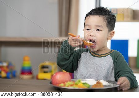 Asian Student Take A Lunch In Class Room By Food Tray Prepared By His Preschool, This Image Can Use