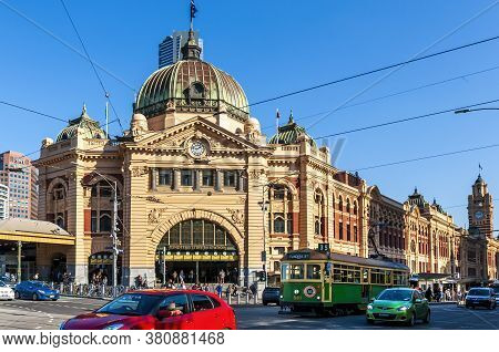 Melbourne, Australia - May 16, 2019: City Tram Moving Along Flinders Street Across The Front Of The