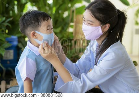 Asian Mother Use Face Mask Protect Her Son Before Go To Preschool, This Image Can Use For Covid19, P