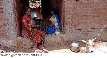 District Katni, India - August 20, 2019: An Indian Village Woman Operating Laptop, Concept For Asian