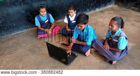District Katni, India - August 20, 2019: Indian Government School Kids Learning About Laptop Technol