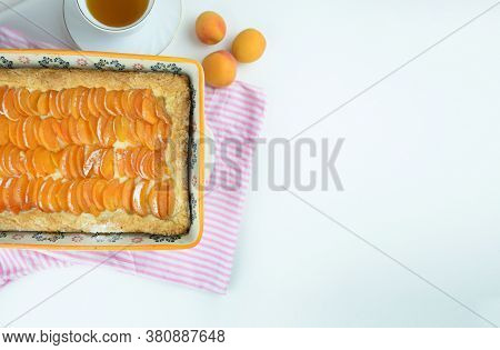 Apricot Pie. Homemade Fruit Pie Made With Fresh Organic Apricotes On A White Background, Copy Space.