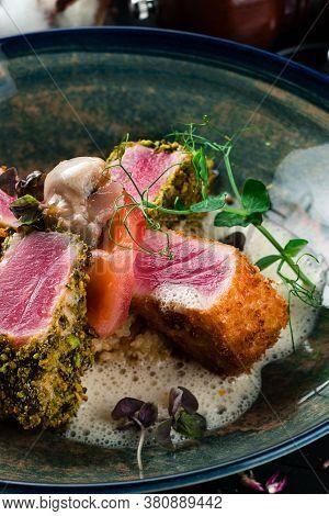Lightly Seared Tuna Steak With Almonds. Close Up Lightly Fried Tuna
