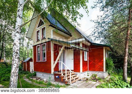 One-storey Wooden Summerhouse With Attic In Russia In Summer