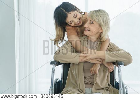 Happy Smile. Caucasian Senior Woman Hugs Asian Granddaughter. Concept Together Family Mix Skin, Love