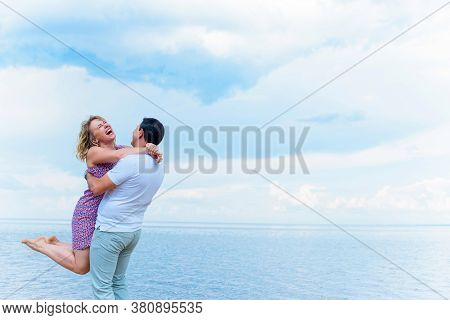 Happy Middle Age Couple In Love Having Fun Outdoors And Smiling. Romantic Happy Couple Kissing And H