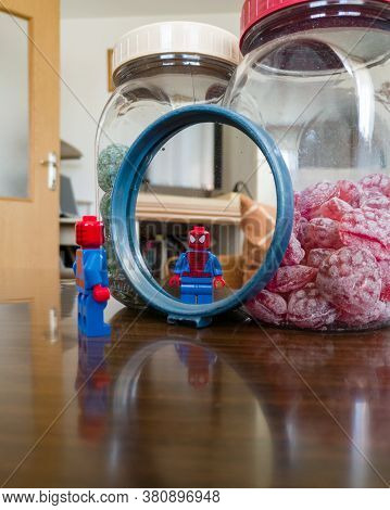 Bosnia And Herzegovina - April 9, 2020: A Reflection Of A Lego Children's Toy, A Superhero Spiderman